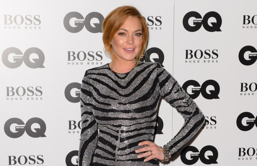 """FILE- In this Sept. 2, 2012 file photo, Lindsay Lohan arrives for the GQ Men Of The Year Awards 2014 at a central London venue, London. A Los Angeles judge on Wednesday Feb. 25, 2015, ordered Lohan to re-do 125 hours of community service after a prosecutor determined the actress was given credit for time she spent performing in a London production of """"Speed-the-Plow."""" (Photo by Jonathan Short/Invision/AP, File)"""