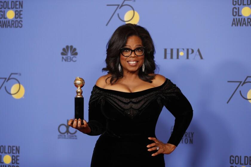 Oprah Winfrey in 2018, holding a Golden Globe award