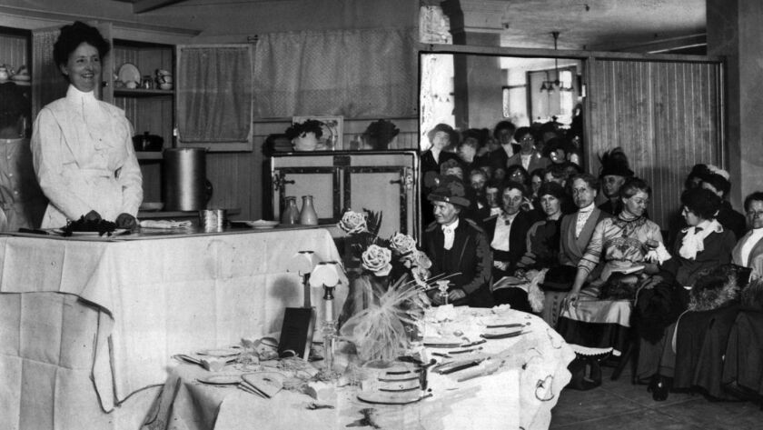 "Feb. 12, 1914: Bertha Haffner-Ginger, left, during the ""The Times' School of Domestic Science"" — a cooking class — held at the Los Angeles Times."
