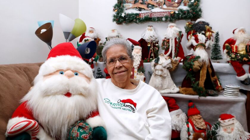 Maria Sands, 87 of Burbank, has been collecting Santa Claus toys and items for about 35 years, sitti