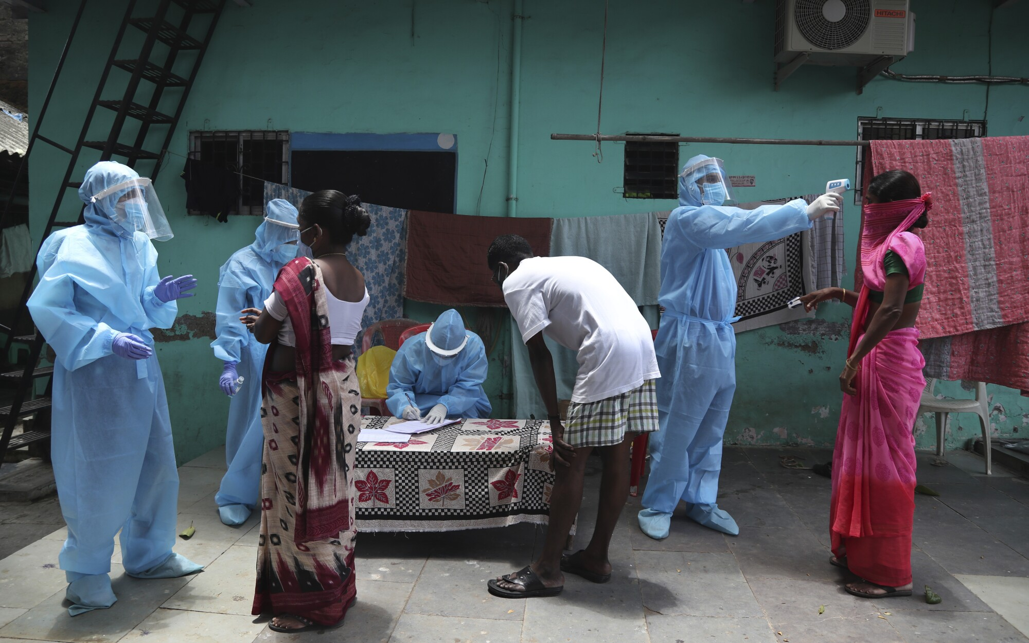 Doctors conduct a free medical camp in Dharavi, a slum in Mumbai, India.