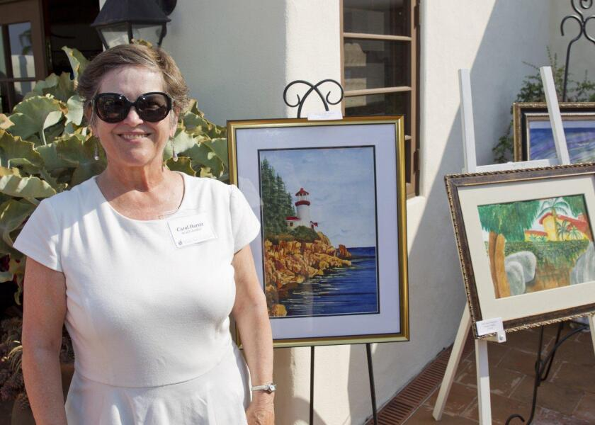"Carol Harter (Art Guild Bd Member) with her painting ""Maine Light House"""