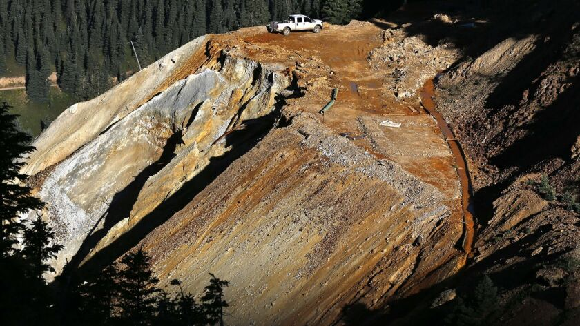 FILE - In this Aug. 13, 2015 file photo, wastewater flows down a trough, right, from the site of the