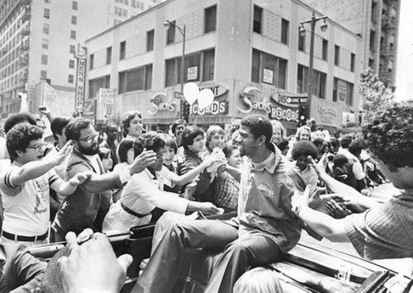 Laker fans mobbed Johnson during the downtown parade in a way that is unthinkable today.