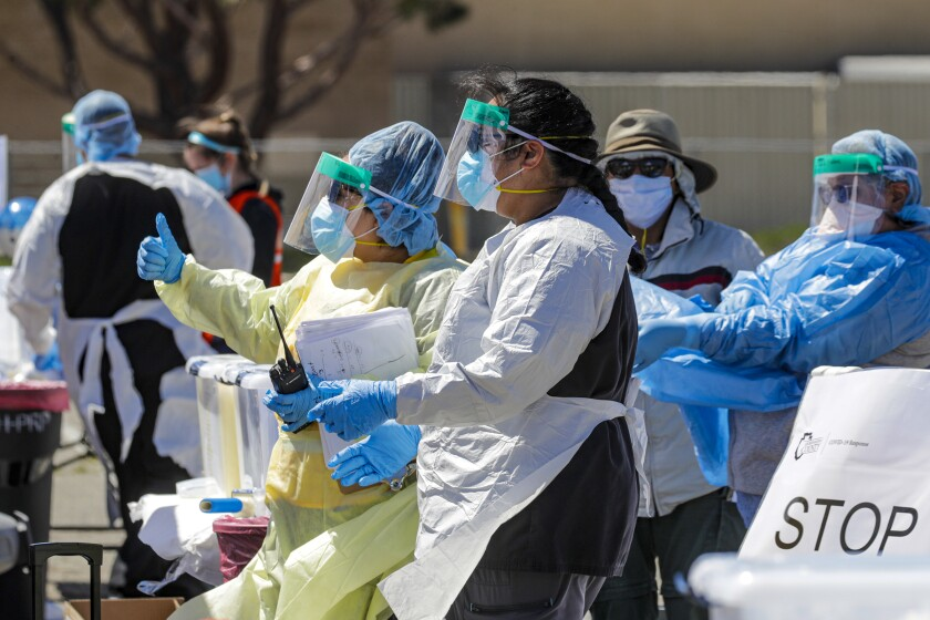 Coronavirus drive-through testing takes place in Victorville.