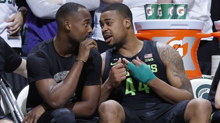 Michigan State's Nick Ward, right, talks with Joshua Langford, center, and Jack Hoiberg, left, while