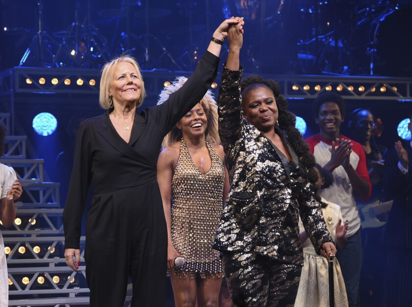 """FILE - Director Phyllida Lloyd, left, and playwright Katori Hall take a bow during the curtain call on opening night of """"Tina – The Tina Turner Musical"""" in New York on Nov. 7, 2019. Most playwrights who dip their toes into musical theater for the first time go small. Not Katori Hall: Her first assignment was to capture the life of a musical giant — Tina Turner. (Photo by Evan Agostini/Invision/AP, File)"""