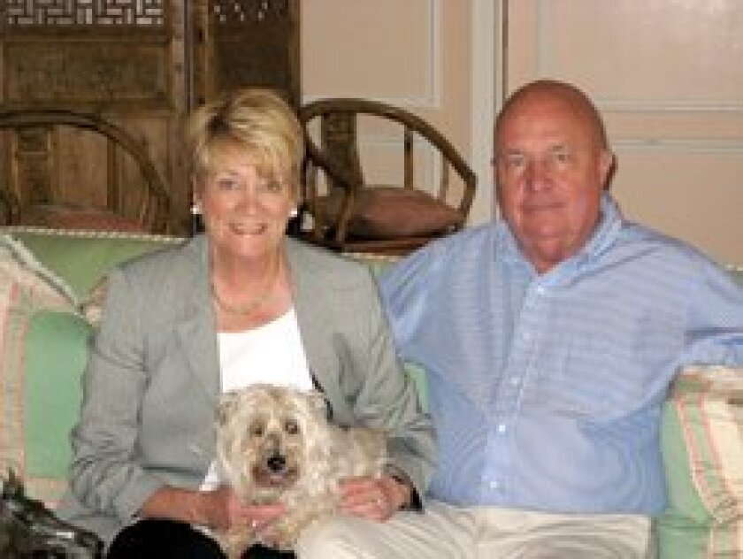 Rollin and Bonnie Baugh at their Rancho Santa Fe home. Their dog is Kerry, a Cairn terrier.