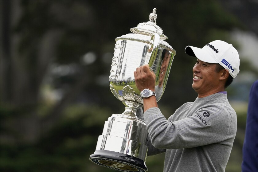 Collin Morikawa holds the Wanamaker Trophy after winning the PGA Championship.