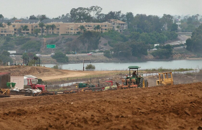 View looking north of the Carlsbad Strawberry Fields site where a shopping center is planned. In the distance is the Interstate 5 and the adjacent Aqua Hedionda Lagoon.