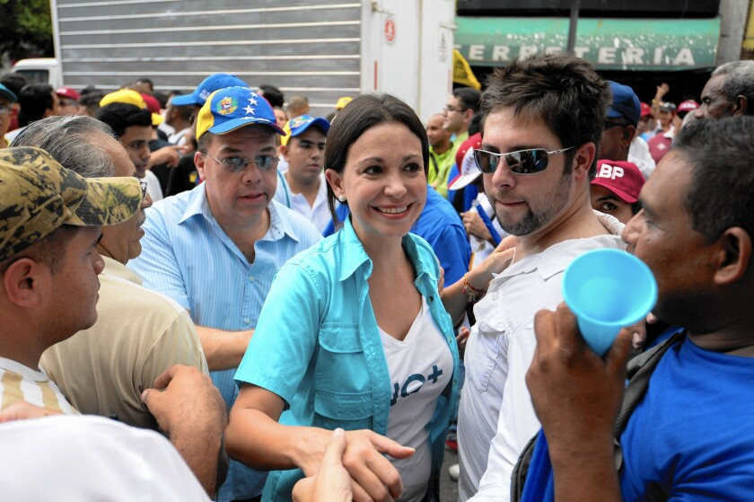 Venezuelan opposition leader Maria Corina Machado has been expelled from the National Assembly and barred from Sunday's election. But she has rallied support for other opposition candidates, who may be primed to win a majority.