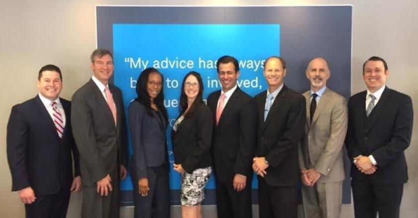 The staff of the Charles Schwab La Jolla branch (from left) Lesandro Mena, Christopher Chandler, Rashida Randle, Tanya Martinez, Derek Anthony, Mark Huhn, Randy Schechter, Ryan Henry