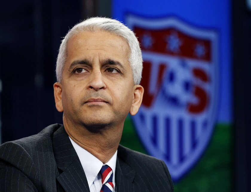 """FILE - This Oct. 10, 2014, file photo shows Sunil Gulati, president of the United States Soccer Federation, during a press conference in Bristol, Conn. Gulati believes his sport could receive a big domestic boost from hosting the World Cup in 2026. He also thinks scandal-plagued FIFA would benefit immensely from putting its biggest show back on steadier ground. """"It's probably now at least as important for the international community to be in the United States as it is for the United States, in terms of hosting the World Cup,"""" Gulati said Thursday, April 9, 2015. (AP Photo/Elise Amendola, File)"""