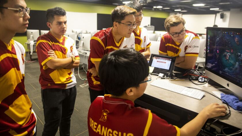LOS ANGELES, CALIF. - NOVEMBER 12: Michael Ahn, center, goes over a replay of his teams last match,