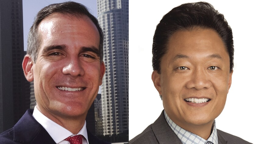 Mayor Eric Garcetti, left, appointed Joel Jacinto to L.A.'s Board of Public Works in 2015. Jacinto has submitted his resignation.
