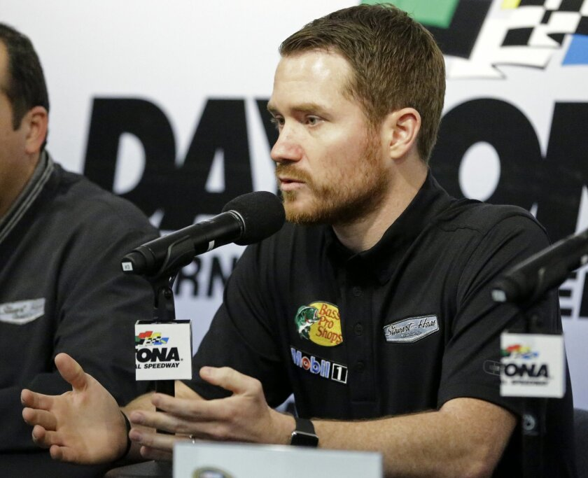 NASCAR driver Brian Vickers answers questions at a news conference at Daytona International Speedway, Friday, Feb. 12, 2016, in Daytona Beach, Fla. Vickers will replace injured Tony Stewart in the Daytona 500 auto race. (AP Photo/John Raoux)