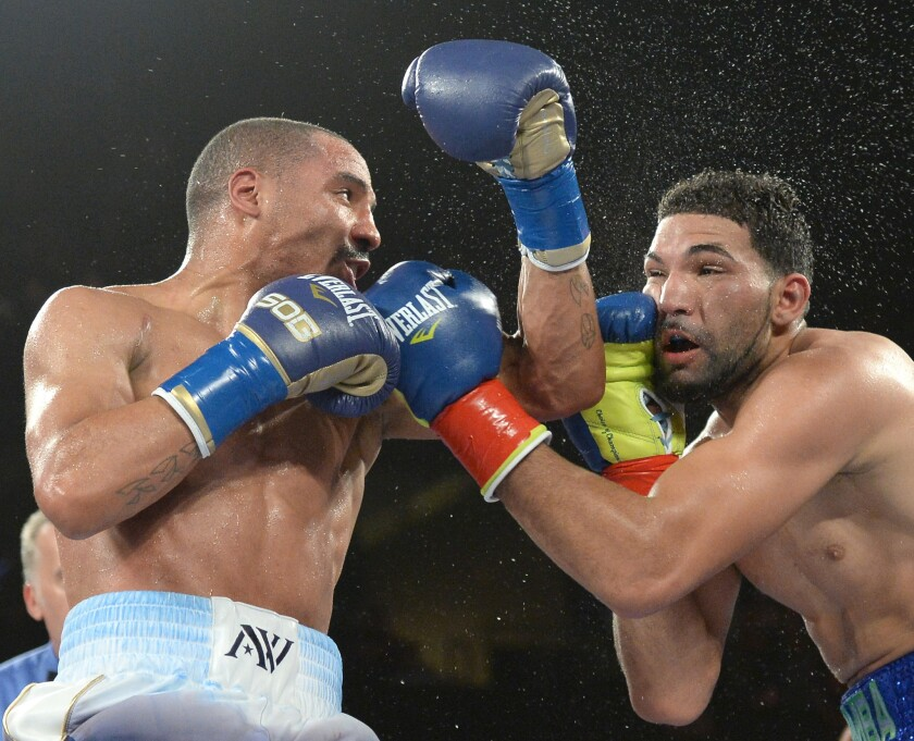Andre Ward lands a punch on Edwin Rodriguez during a super-middleweight bout on Nov. 16, 2013.