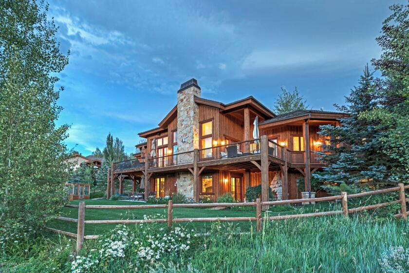 The chalet-style house, built in 2004, sits on more than half an acre.