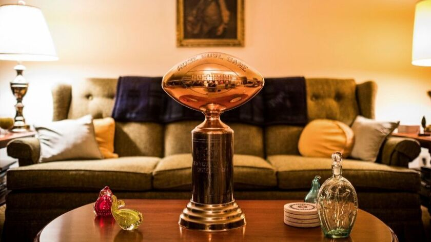 Jim Smith's Rose Bowl trophy sits on display in his home.