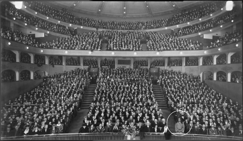 A packed Los Angeles Philharmonic Auditorium in 1925 with one person circled