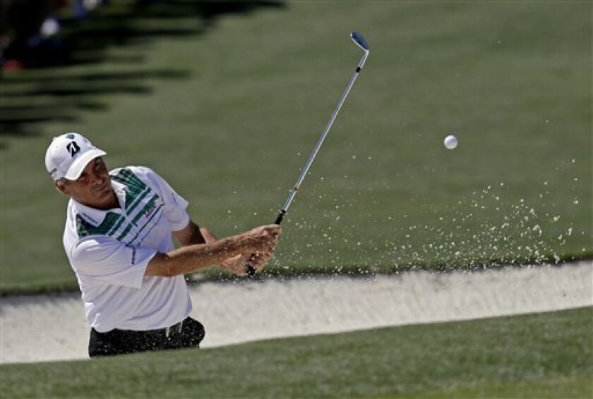 Fred Couples hits out of a bunker on the second hole during the third round of the Masters golf tournament Saturday, April 7, 2012, in Augusta, Ga. (AP Photo/David J. Phillip)