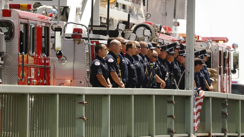 LONG BEACH, CA – JUNE 25, 2018: Long Beach Fire Department firefighters gather at west Willow Stre