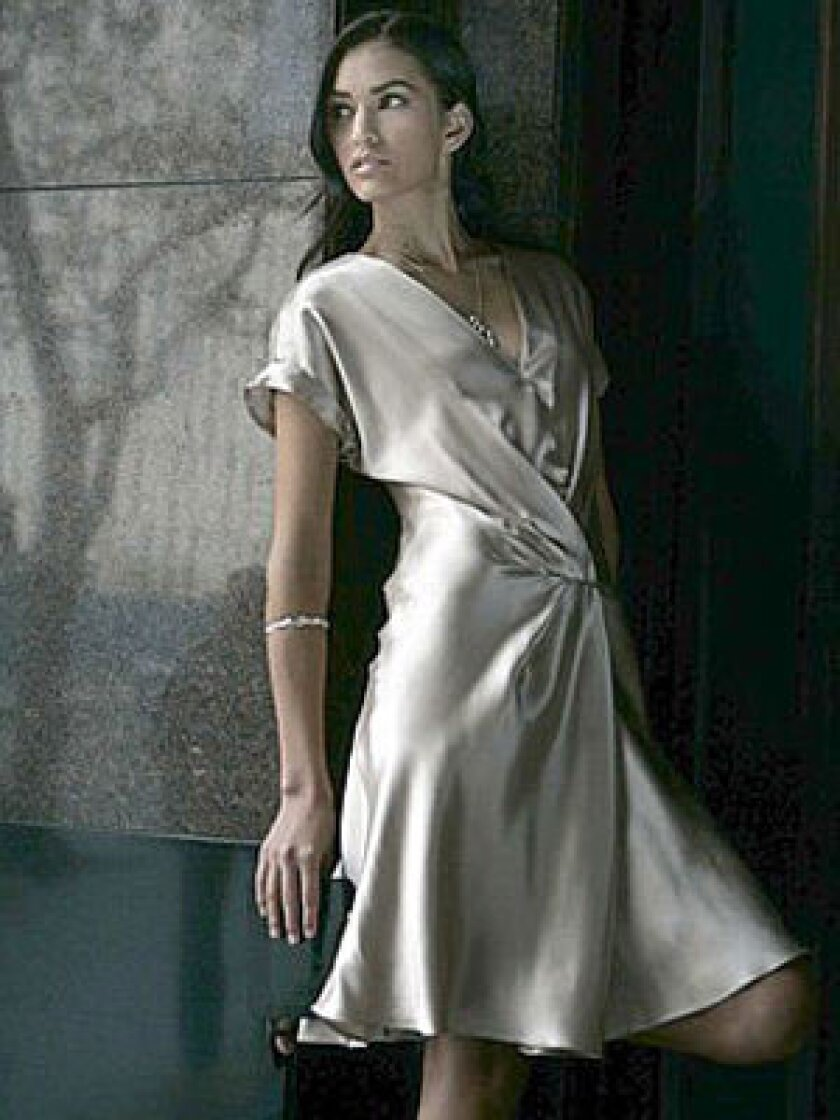 SILVERY SMOOTH: Banana Republic Heritage runway pleat dress, $130 at www.bananarepublic.com; Alex Woo Sweni chunky horn bangle in sterling silver, $448, and large horn pendant in sterling silver, $318, at www.alexwoo.com.