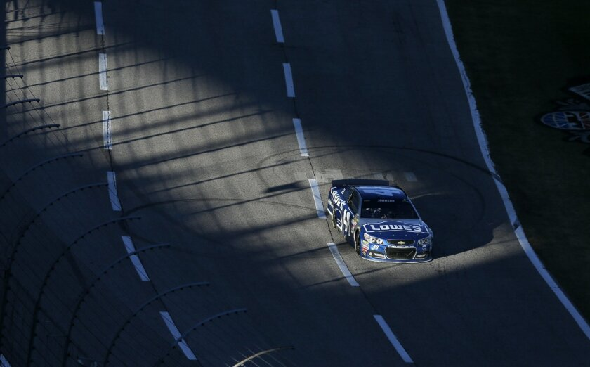 Jimmie Johnson (48) drives during the NASCAR Sprit Cup Series auto race at Texas Motor Speedway in Fort Worth, Texas, Sunday, Nov. 8, 2015. (AP Photo/Tim Sharp)