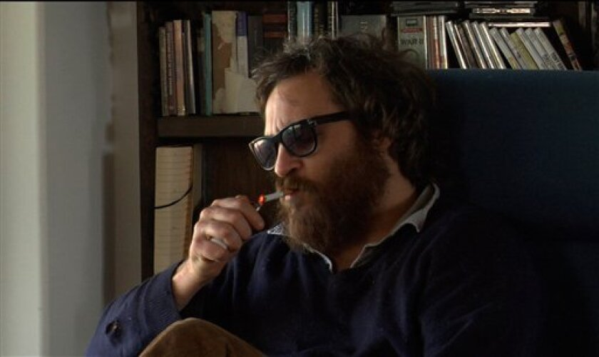 """In this film publicity image released by Magnolia Pictures, Joaquin Phoenix is shown in the film, """"I'm Still Here."""" (AP Photo/Magnolia Pictures)"""