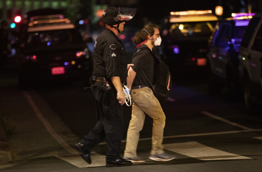 A protester is arrested by Los Angeles police after curfew on June 2.