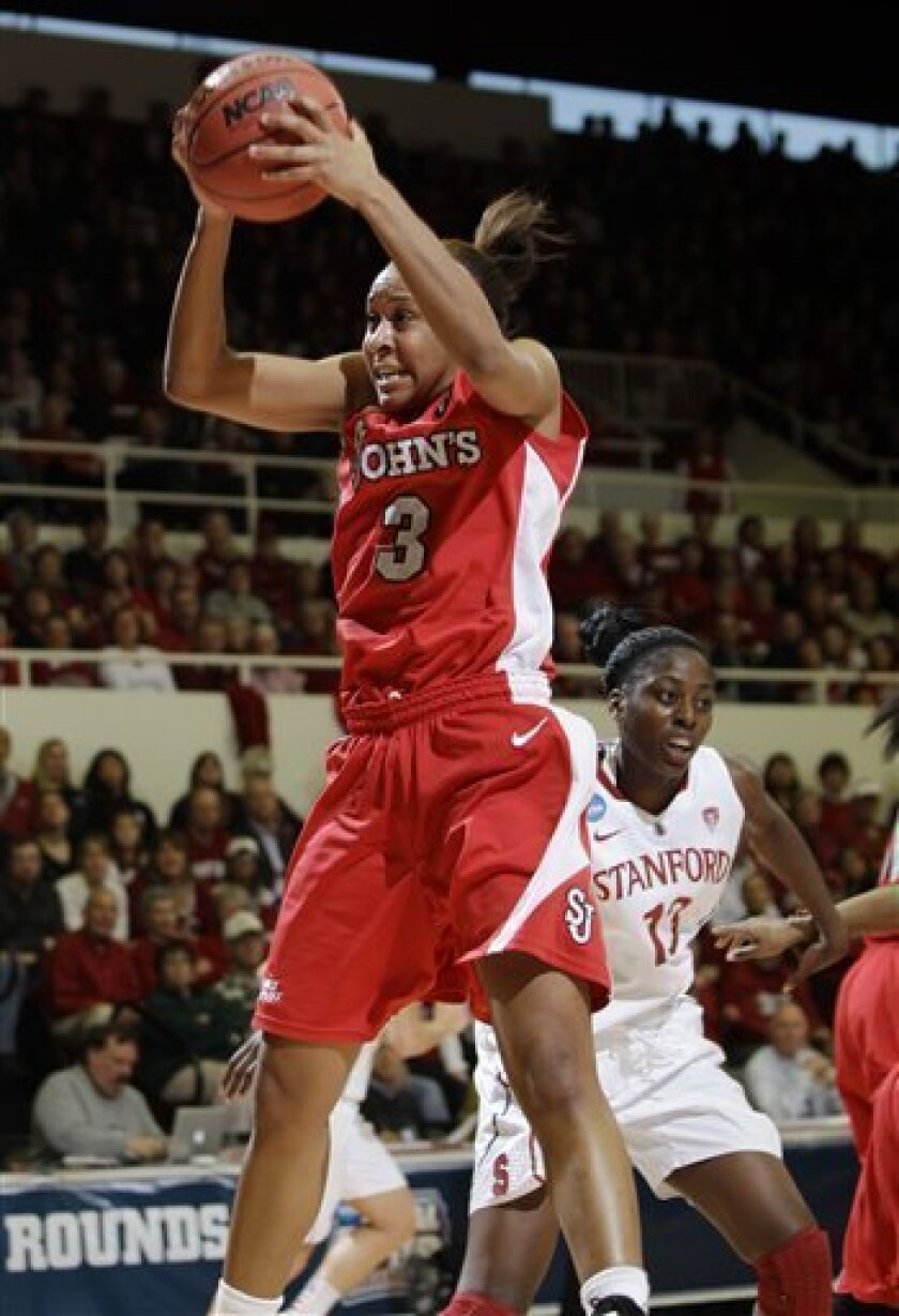 St. John's forward Da'Shena Stevens (3) gets the rebound in front of Stanford forward Chiney Ogwumike, right, in the first half of a second-round NCAA women's college basketball tournament game in Stanford, Calif., Monday, March 21, 2011. (AP Photo/Paul Sakuma)