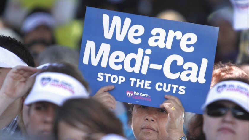 FILE - In this June 4, 2013, file photo, sign-carrying demonstrators representing doctors, hospitals
