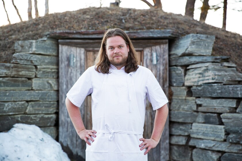 Chef Magnus Nilsson poses for a portrait in front of his famous root cellar at Fäviken.