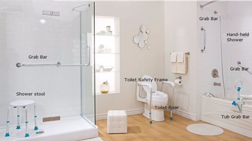 A bathroom with several grab bars and other products.