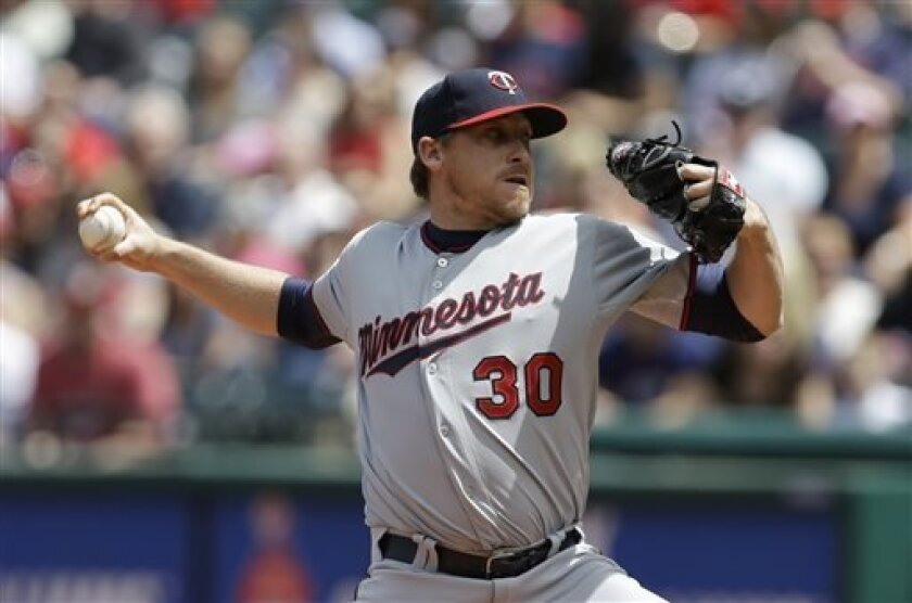 Minnesota Twins starting pitcher Kevin Correia delivers a pitch in the first inning of a baseball game against the Cleveland Indians, Saturday, May 4, 2013, in Cleveland. (AP Photo/Tony Dejak)