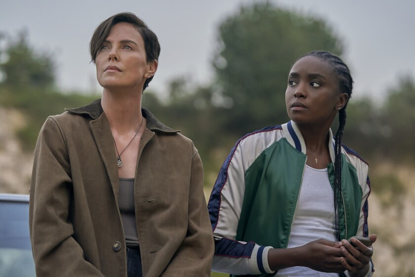 "Charlize Theron, left, and KiKi Layne in the movie ""The Old Guard."""