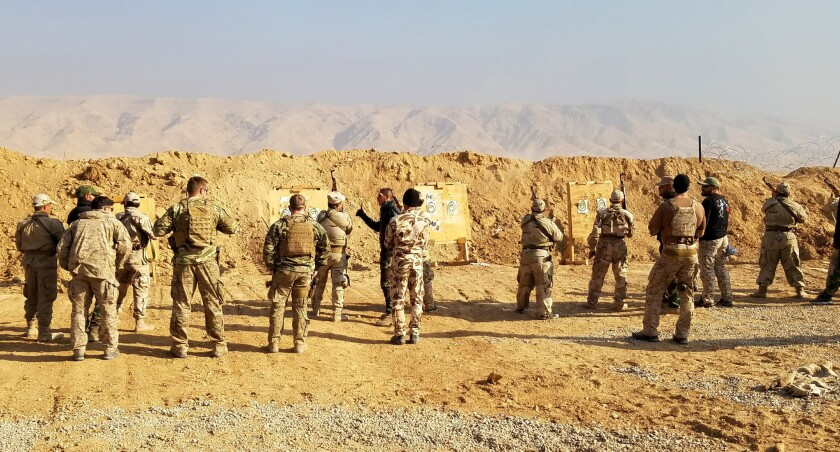 U.S. and coalition special forces train Shiite militia recruits this month at a facility about 55 miles south of Mosul.