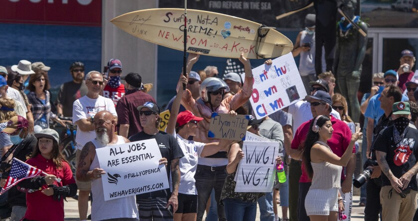 Demonstrators in Huntington Beach protest stay-at-home orders.