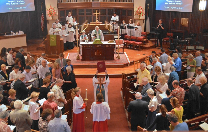 The Rev. Richard Crocker conducts a service at St. James church in 2013.