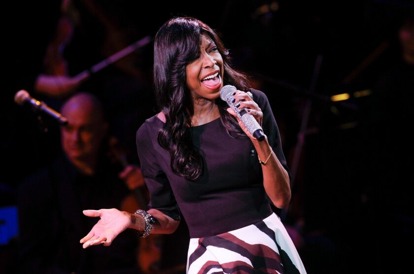 """FILE - In this March 2, 2015 file photo, singer Natalie Cole performs at """"An Evening of SeriousFun Celebrating the Legacy of Paul Newman"""" in New York. The sister of Natalie Cole said she was disappointed by the Recording Academy's tribute to the late singer during Monday's 58th annual Grammy Awards"""