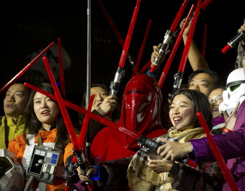 """Chinese Star Wars fans pose with light sabers during a promotional event for """"Star Wars: The Force Awakens"""" at the Great Wall of China near Beijing in October 2015."""
