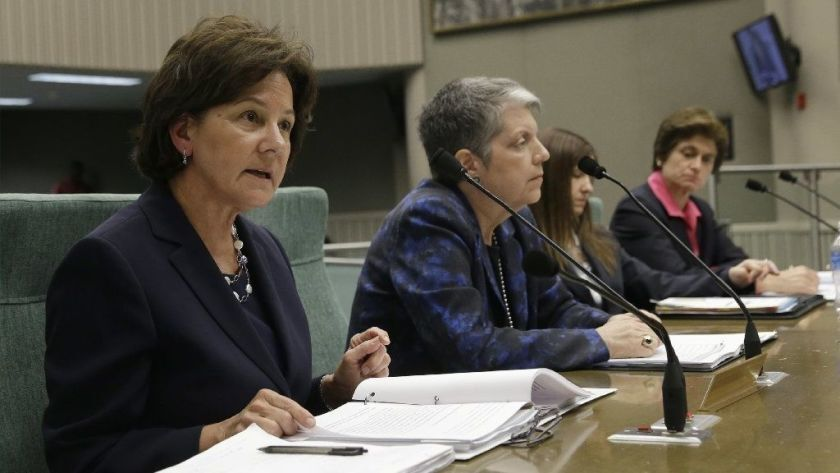 Monica Lozano, left, chair of the UC Board of Regents, discusses the findings of a state audit that blasted the office of UC President Janet Napolitano, second from left, for a lack of transparency during a legislative hearing in May 2017. State Auditor Elaine Howle is at the far right.