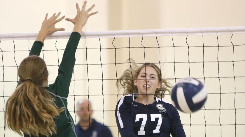 Calvary Chapel's Mackenzie Hill kills the ball uncontested during Orange Coast League girls' volleyb