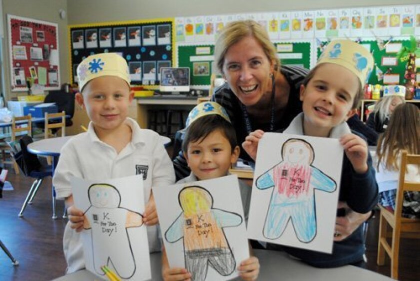 "Trying out kindergarten at Horizon Prep's ""Kindergartner for a Day!""  Colton McQuaid, Dean Kaffka, Cole Campbell with kindergarten teacher Shannon Grove."