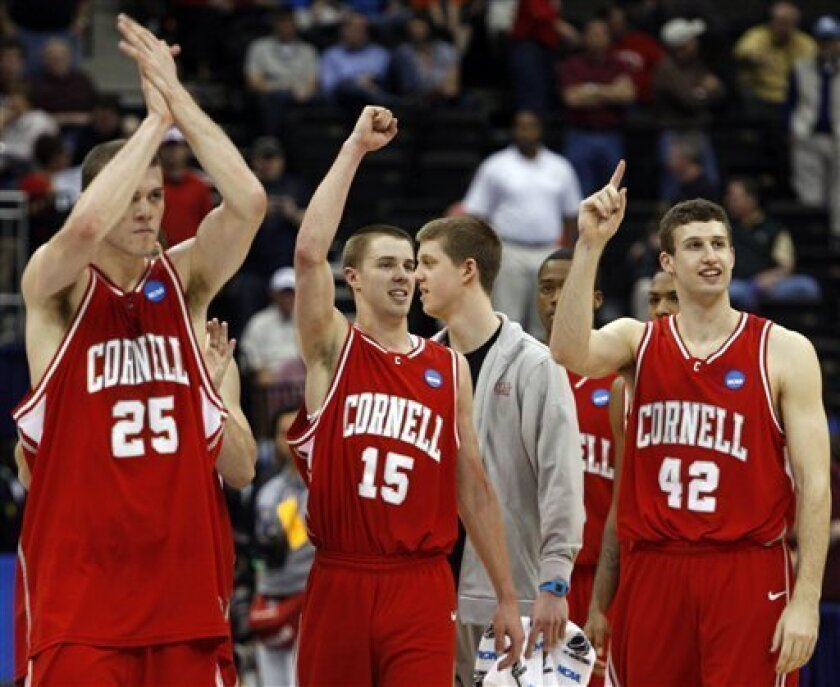 Cornell's Jon Jaques (25) Geoff Reeves (15) and Mark Coury (42) celebrate after defeating Temple 78-65 in an NCAA college first-round  basketball game in Jacksonville, Fla., Friday, March 19, 2010. (AP Photo/Steve Helber)