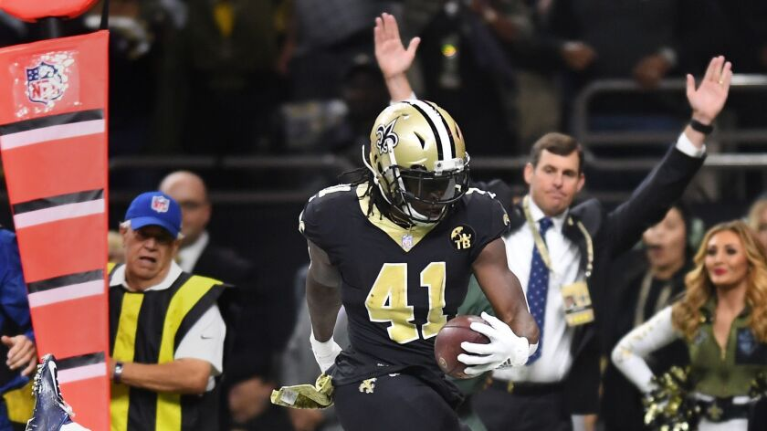 NEW ORLEANS, LOUISIANA, NOVEMBER 4, 2018-Saints running back Alvin Kamara scores a touchdown over ra