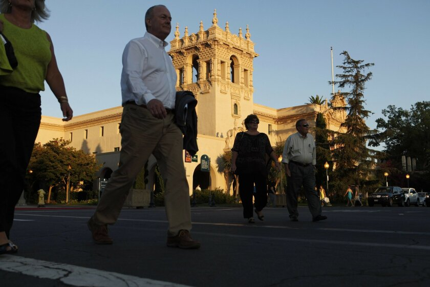 Pedestrians in the Plaza de Panama at Balboa Park. In the background is the House of Hospitality. Photo by John R. McCutchen/San Diego Union-Tribune/Copyright 2010 San Diego Union-Tribune