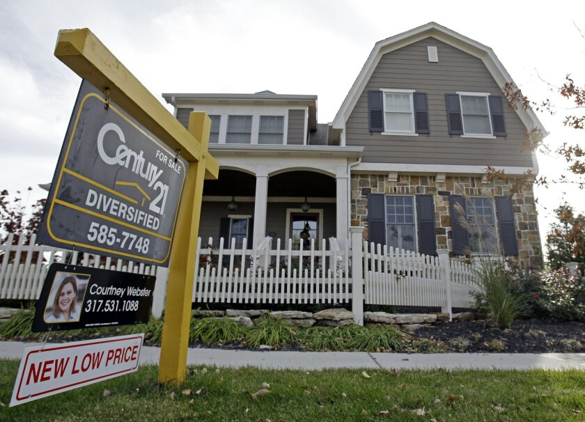 FILE - This Oct. 20, 2009, file photo, shows a home with a reduced price for sale in Carmel, Ind., neighborhood. Short of cash and unsettled in their careers, young Americans are waiting longer than ever to buy their first homes. The delay reflects a trend that cuts to the heart of the financial challenges facing millennials: Renters are struggling to save for down payments. (AP Photo/Michael Conroy, File)