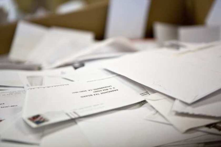 Boxes of opened and emptied envelopes at the California Franchise Tax Board.