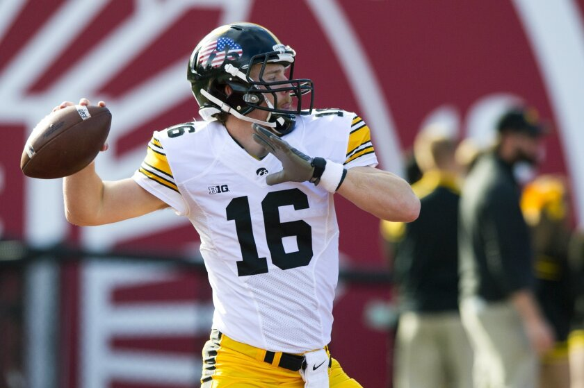 Iowa quarterback C.J. Beathard (16) warms up on the field before the start of an NCAA college football game in Bloomington, Ind., Saturday, Nov. 7, 2015. (AP Photo/Doug McSchooler)